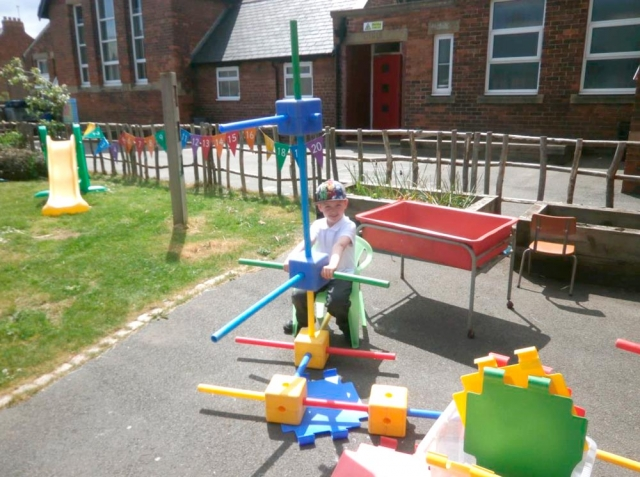 Driving a formula one car we made with the large construction.