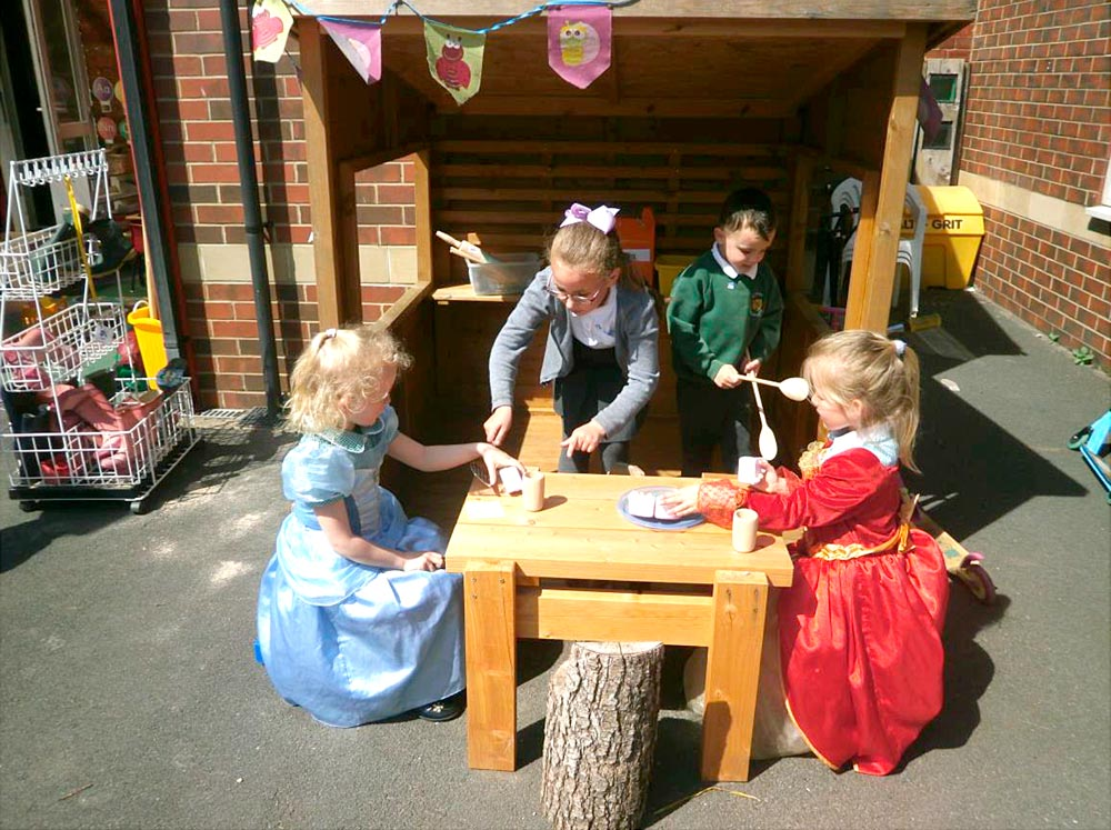 Reception class serving tea for our princess guests.