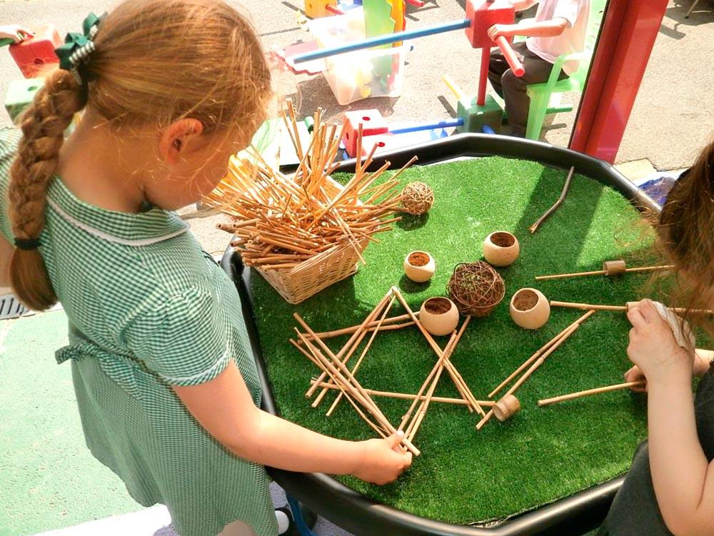 Creating sculptures using natural materials.